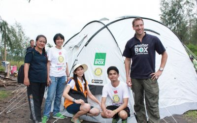 ShelterBox response volunteers with disaster relief tent in Philippines