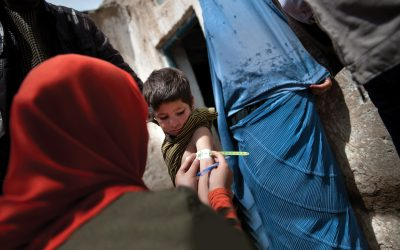 A child is examined by a UNICEF health worker to assess for malnutrition