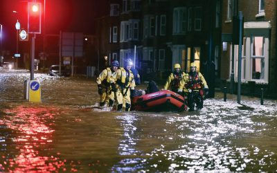 rescue team looking for people stranded by the floods