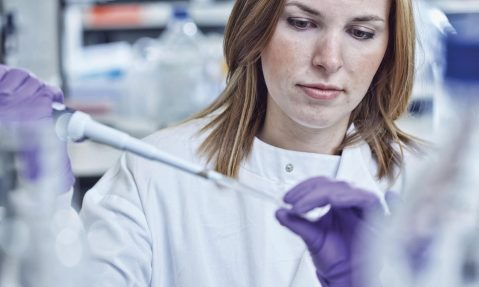 researcher in laboratory fighting disease Multiple Sclerosis
