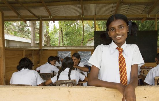 Girl in school in India receiving education and literacy