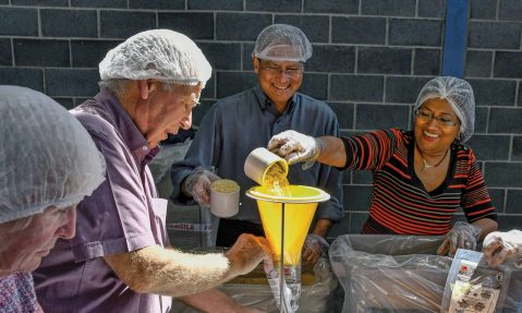 Rotary volunteers pack meals for Africa for Rise Against Hunger