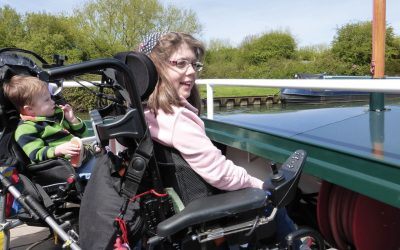 children with disabilities enjoy boat trip with the Willow Trust