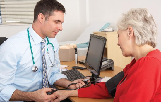 doctor checks blood pressure for stroke symptoms