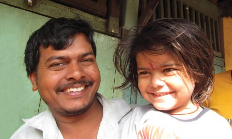 A child and her father smile after receiving polio vaccination India