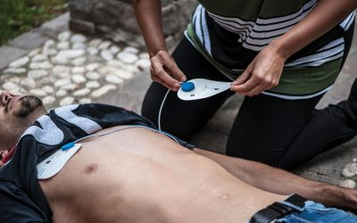 victim of cardiac arrest receives defibrillator help