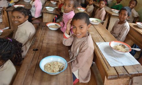 children enjoy meal at school packed by Rise Against Hunger volunteers