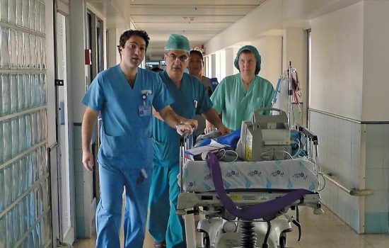 doctor's rush a patient into surgery for Save a Child's Heart