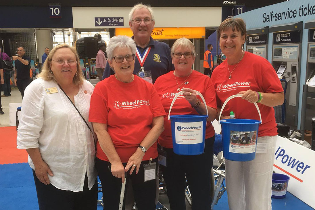 rotary members fundraising wheelpower