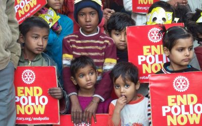 children holding a rotary end polio now sign