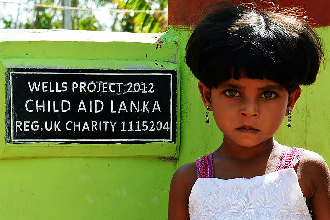 well project providing clean water child aid lanka rotary foundation