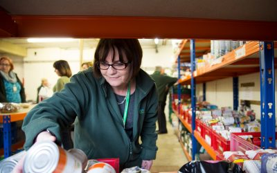 woman sorting food at the foodbank