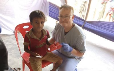 medical camp set up for the refugees who have fled to bangladesh. boy and doctor