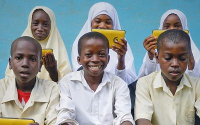 children benefitting from technology tablets for education purposes