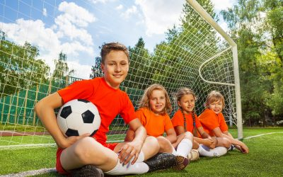 kids football playing games goal smiling