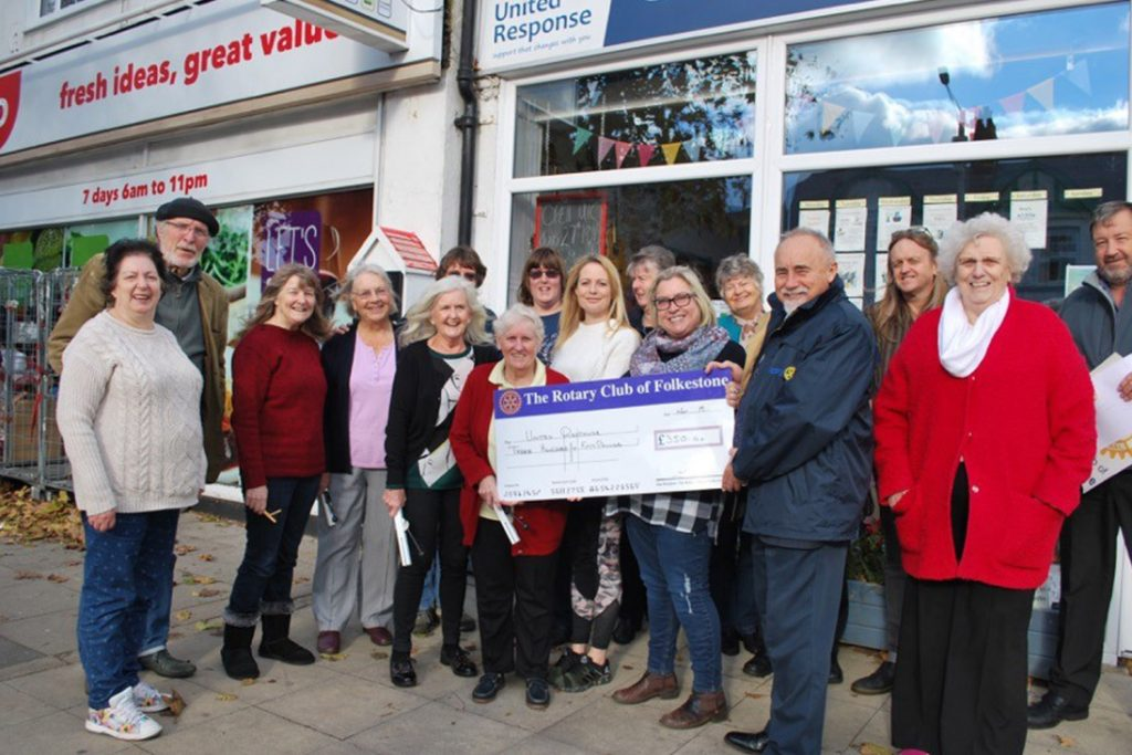 rotary members smiling cheque fundraising for christmas