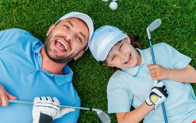 golf boy father grass golf laughing smiling playing
