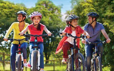family bike ride summer smiling fun fundraiser