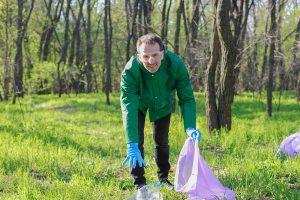 man volunteer clean up plastic