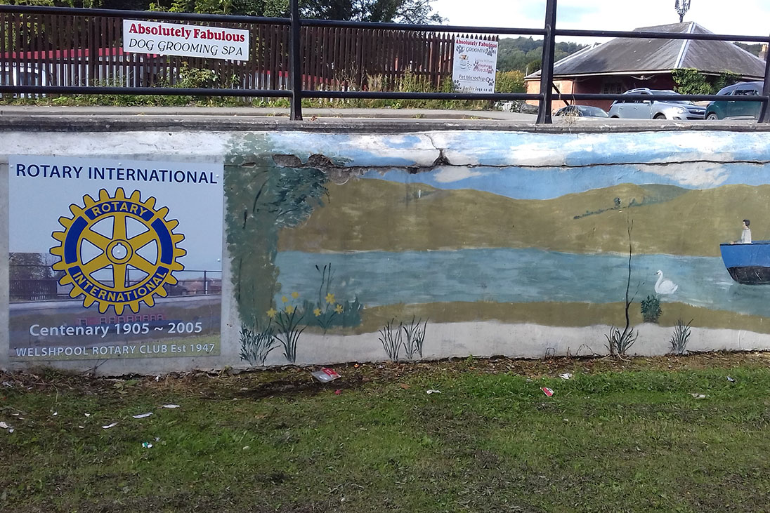 rotary sign and mural welshpool