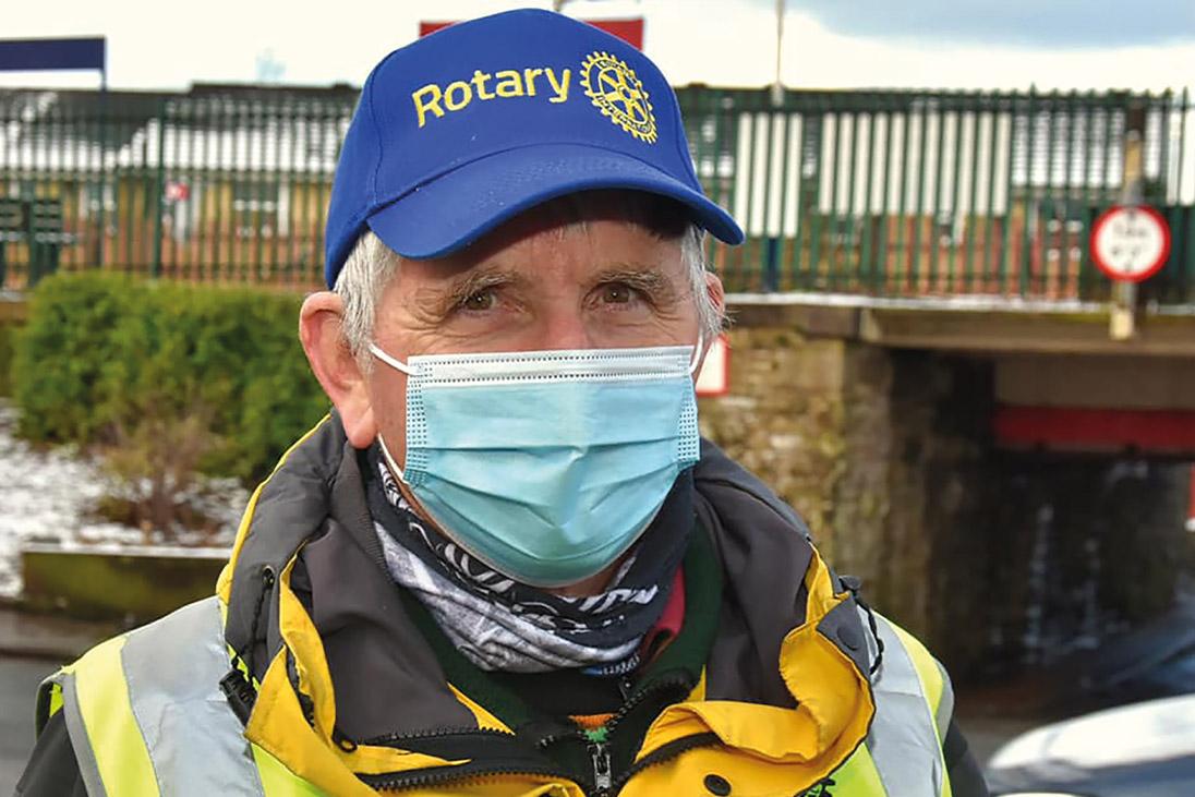 rotary volunteer wearing mask